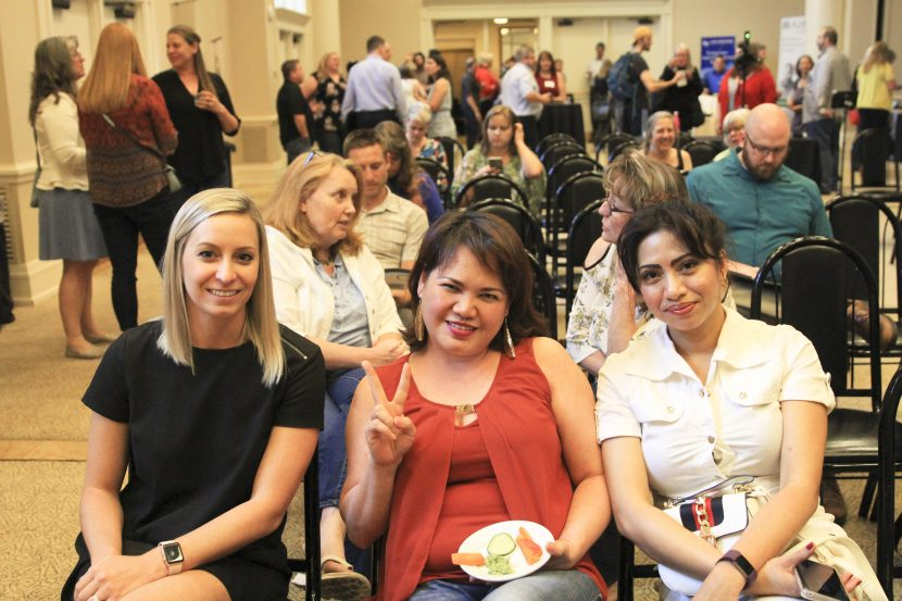 Women seated at tech job event